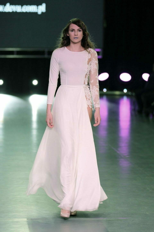 A long and asymmetrical wedding dress