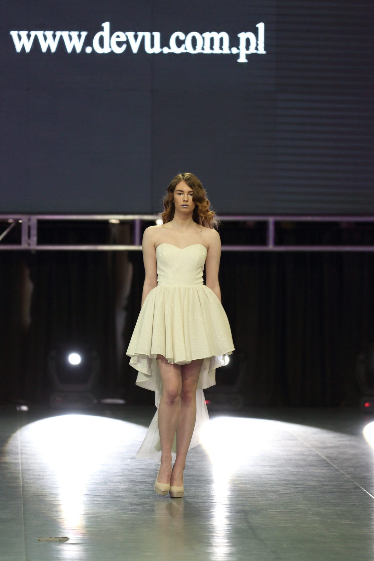 Short wedding dress with a long tail in the front